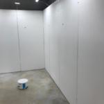 Temporary walling creating several walk ways in a warehouse