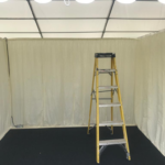 small stand in marquee and yes hid our walls in silk drapes 1